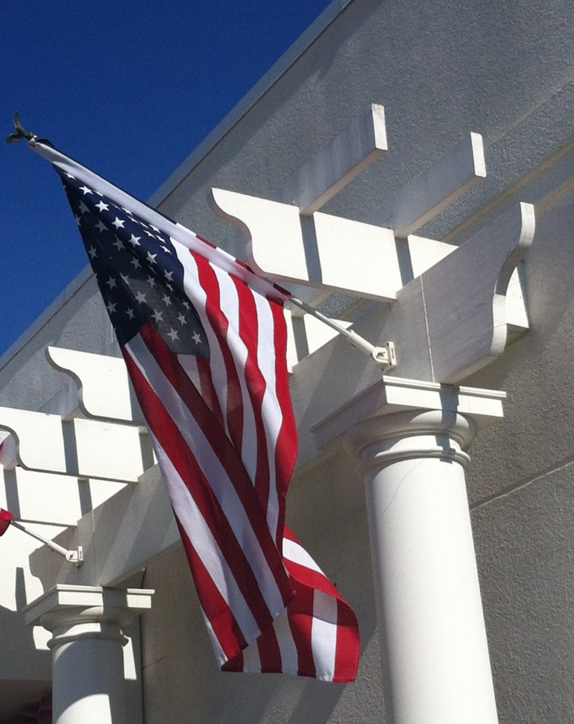 Flag outside of Tipton & Hurst main store in Heights