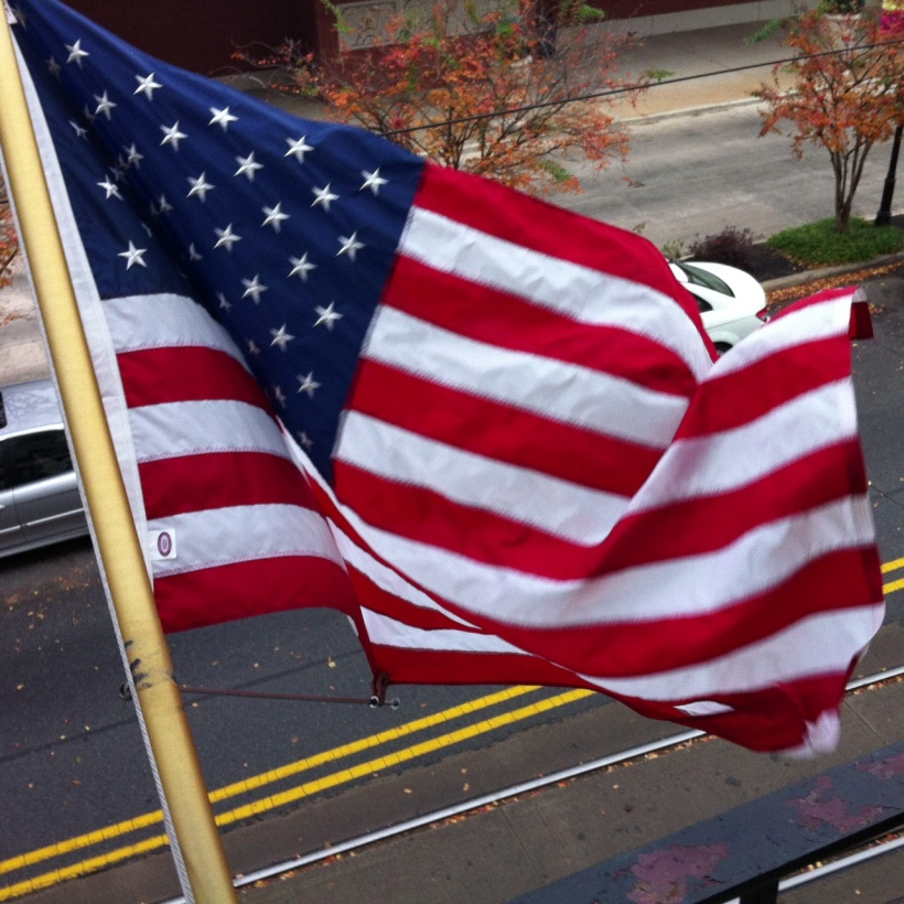 The stars and stripes unfurled from the balcony of the Capital Hotel.