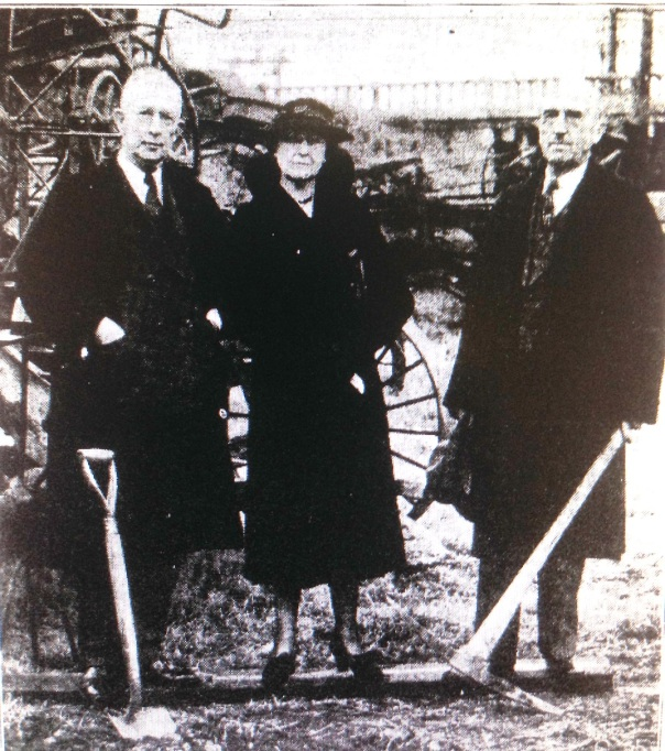 ARKANSAS DEMOCRAT photo of Mayor Overman, Mrs. Robinson and Mr. Allaire at the groundbreaking. The Broadway Bridge balustrades are visible in the background.
