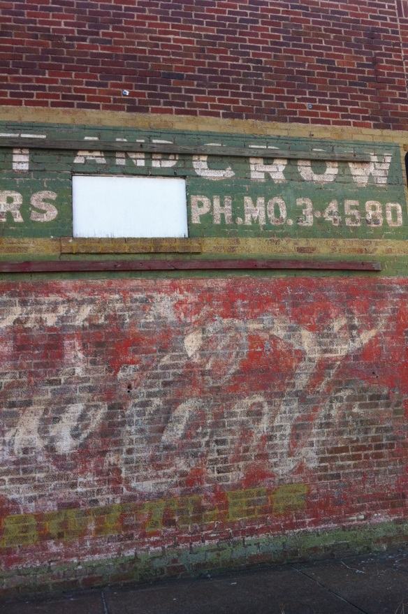 Faded advertisement at 12th and Cedar.