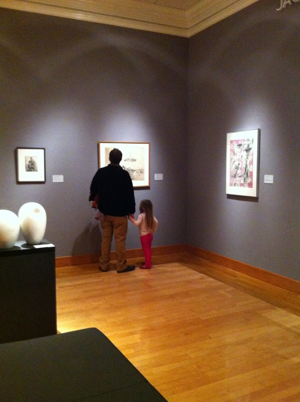 A father and daughter enjoying time together at the Arkansas Arts Center.