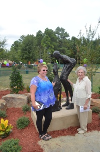 """Sculptor Lorri Acott & City Director Joan Adcock with """"Who Rescued Who"""""""
