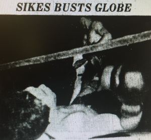 Boxer Al Globe lays in the ring after being knocked down by Bob Sikes in this GAZETTE staff photo