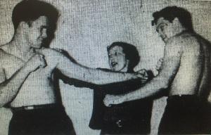 Boxer Bob Sikes, GAZETTE staffer Lou MacDuff and boxer Joe Regan in a GAZETTE staff photo