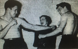 Boxer Bob Sikes, GAZETTE staffer Lou MacDuff and boxer Joe Regan in a GAZETTE staff photo